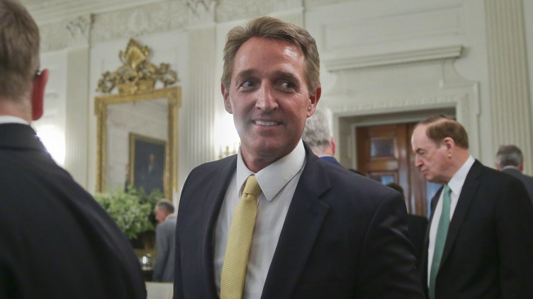 Sen. Jeff Flake, R-Ariz., center, attends a luncheon with other GOP senators and President Donald Trump on July 19 at the White House.