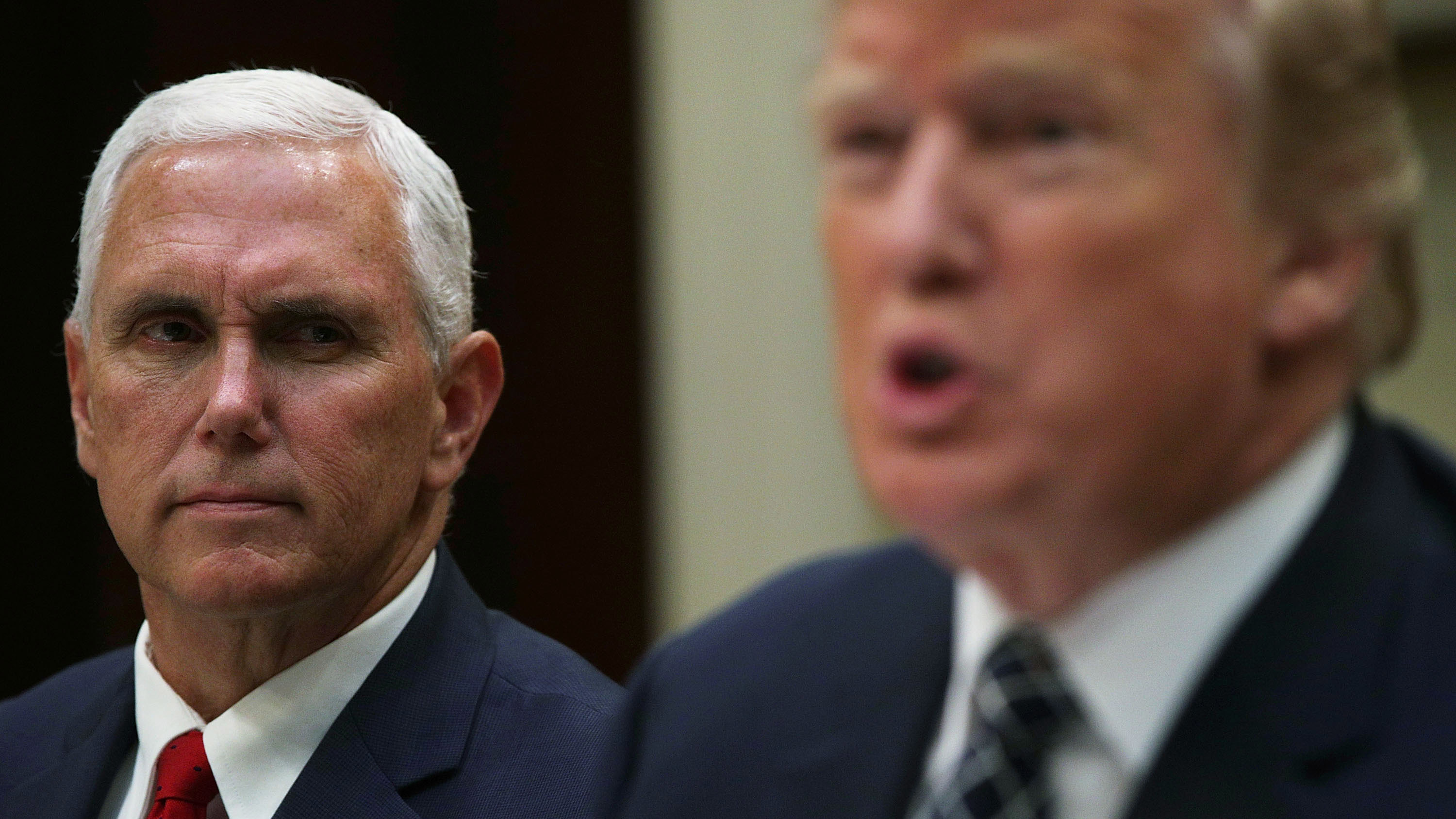 Vice President Mike Pence listens as President Donald Trump speaks to members of the media during an event at the White House on July 18, 2017.