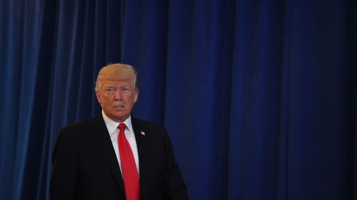 President Donald Trump arrives to speak to the press about protests in Charlottesville, Va., on Saturday at Trump National Golf Club in Bedminster, N.J.