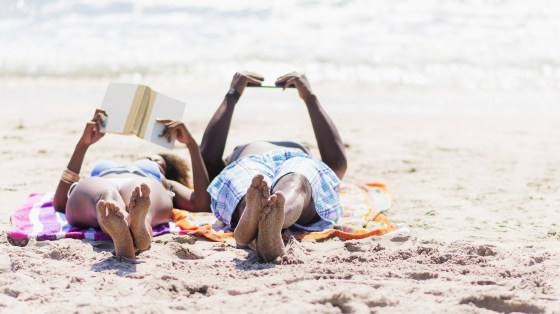 Couple relaxing together on beach.