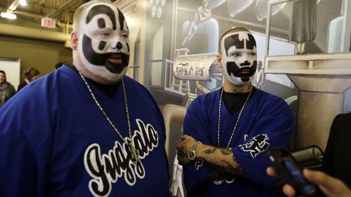 "Joseph ""Violent J"" Bruce, left, and Joseph ""Shaggy 2 Dope"" Utsler, members of the Insane Clown Posse after a news conference in Detroit on Jan. 8, 2014. Fans of the band call themselves Juggalos."