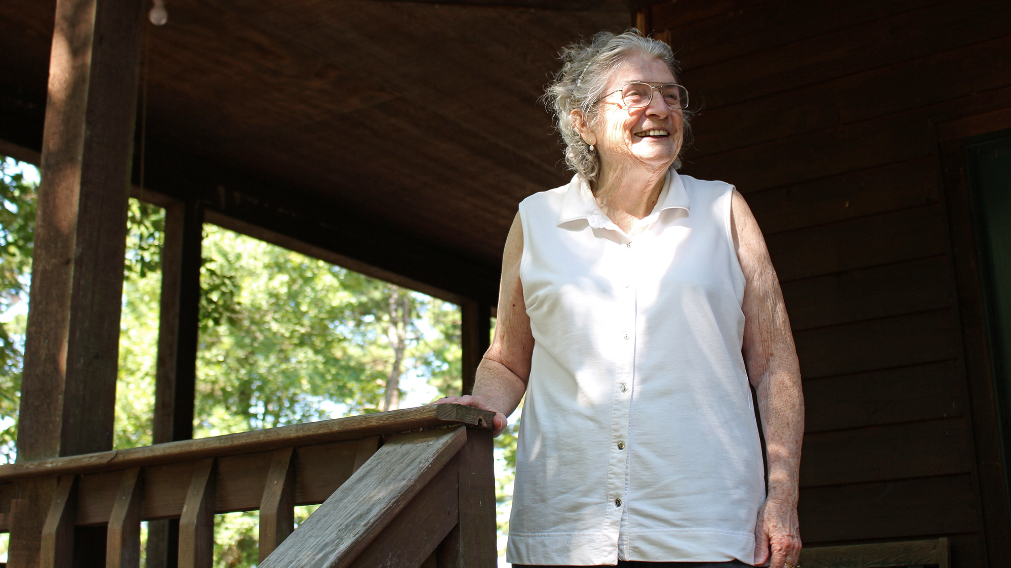Lulabelle Berry surveys the 600 acres she and her husband, Jimmy, own in the Ozarks near Mountain View, Ark. Berry walks laps on her porch to aid her recovery from a stroke. She says she