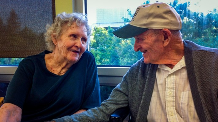 Gloria Single and her husband Bill Single in the dining hall of the skilled nursing floor at Pioneer House, Sacramento. AARP attorneys say states need to more tightly enforce laws that prohibit illegal evictions of the sort that separated the Singles, and sped up her physical decline.