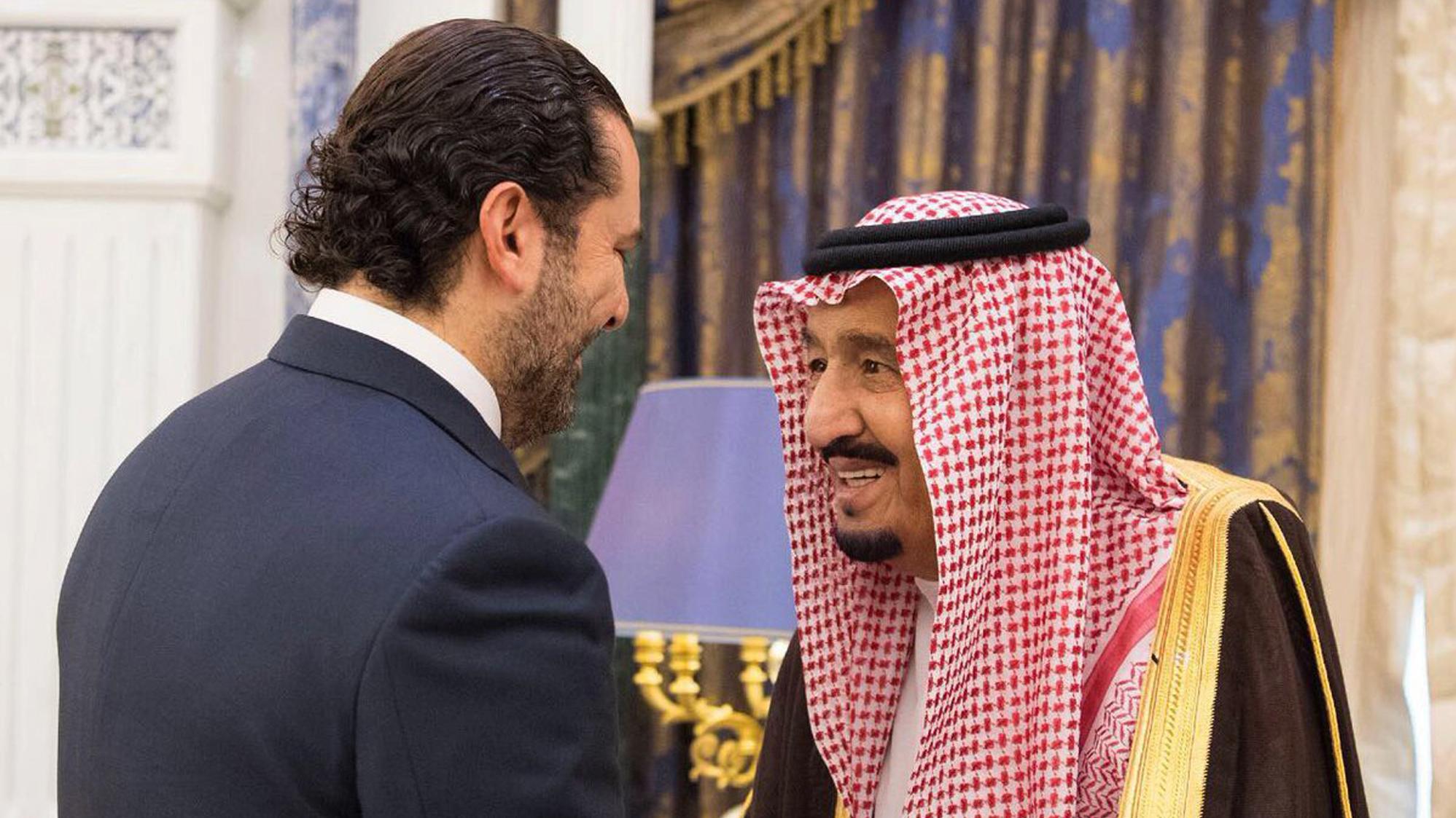 Saudi King Salman (right) shakes hands with outgoing Lebanese Prime Minister Saad Hariri in Riyadh, Saudi Arabia.
