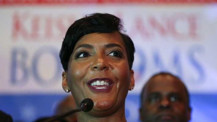 Atlanta mayoral candidate Keisha Lance Bottoms declares victory during an election-night party on Wednesday, but with a margin of about 750 votes, opponent Mary Norwood is calling for a recount.