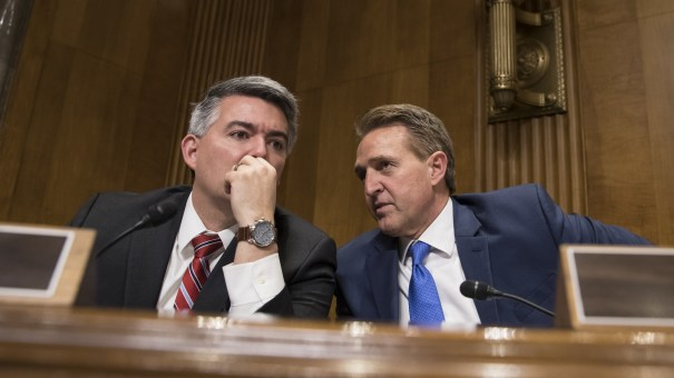 Colorado Republican Sen. Cory Gardner, left, and Arizona Republican Sen. Jeff Flake confer as the Senate Foreign Relations Subcommittee on the Western Hemisphere examines attacks on American diplomats in Havana, on Capitol Hill in Washington, Tuesday.