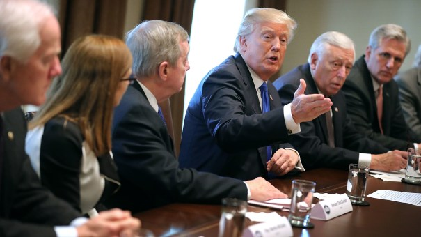 President Trump presides over a meeting about immigration with Republican and Democratic members of Congress at the White House on Tuesday. Congress and the White House are trying to work out an immigration deal prior to Jan. 19.