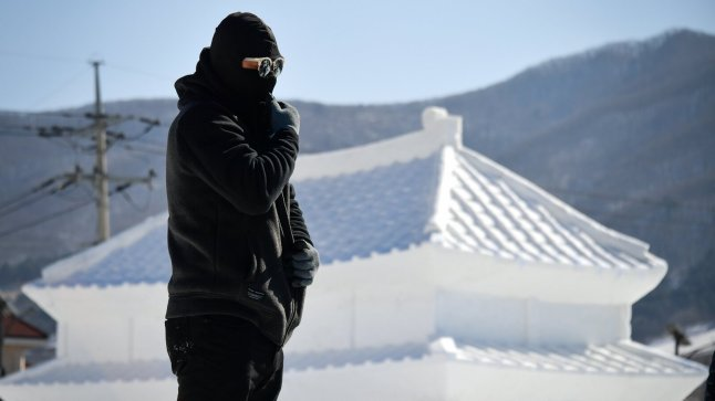 Someone is completely bundled up for the Winter Olympics in Pyeongchang