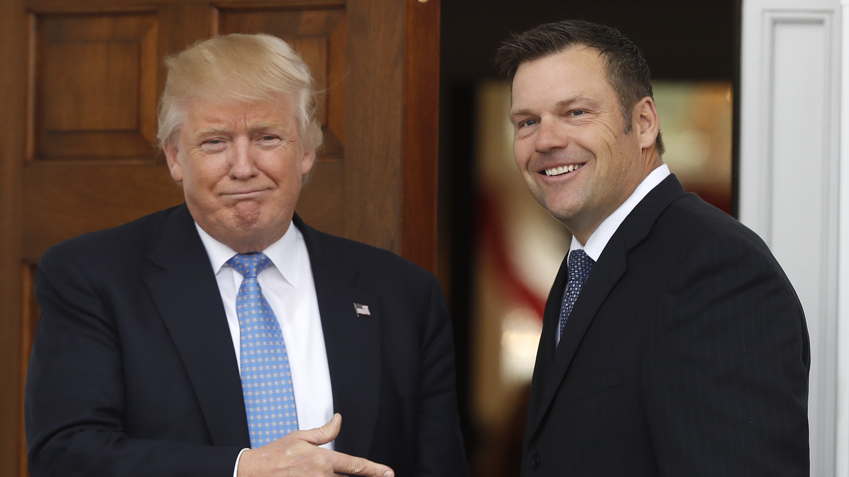 Kansas Secretary of State Kris Kobach and then-President-elect Donald Trump at the Trump National Golf Club in Bedminster, N.J., in November, 2016.