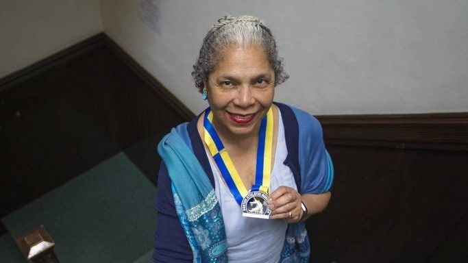 """If my life were to end next week ... I want to feel like I have made a contribution,"" said Carol Martin, seen here holding her 2018 Boston Marathon medal."