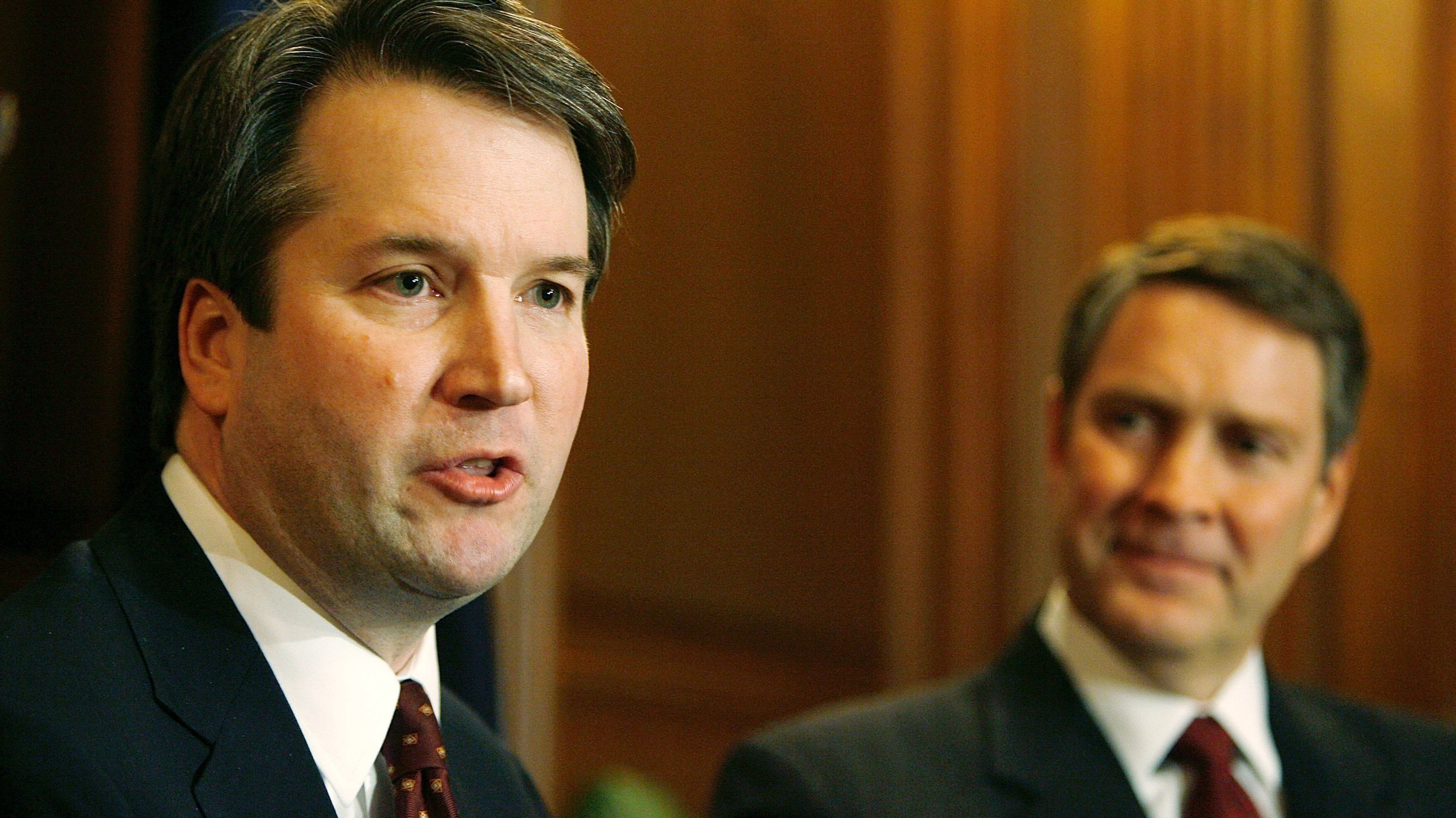 Brett Kavanaugh, left, speaks in 2006 when he was a nominee for the position he currently holds as a federal judge on the D.C. Circuit. Then-Senate Majority Leader Bill Frist of Tennessee looks on.
