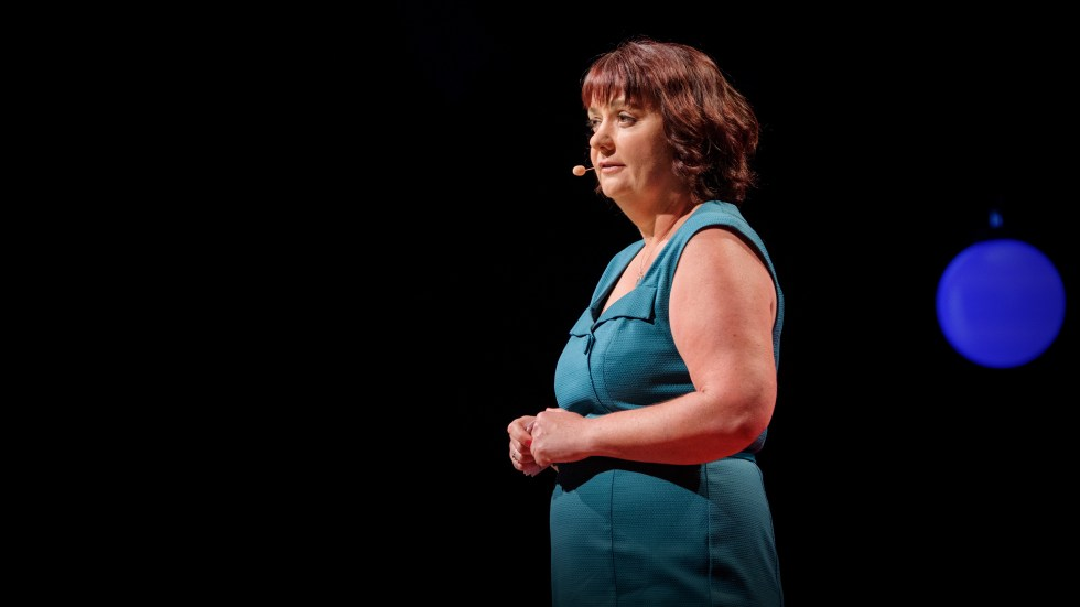Michelle Knox on the TED stage.