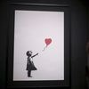 'We Just Got Banksy-ed': 'Girl With Balloon' Sells For $1.4M Before Self-Destructing