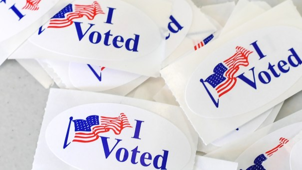 """I voted"" stickers pile up Tuesday at a polling station in Irvine, Calif. Across the country, in Rochester, N.Y., voters found a fitting use for their own stickers: placing them on the headstone of suffragist Susan B. Anthony."