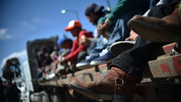 Migrants from Central America ride in a truck Monday as they travel toward the U.S. on the Mexico City-Puebla highway. Thursday, the Trump administration issued new a new rule for asylum-seekers.