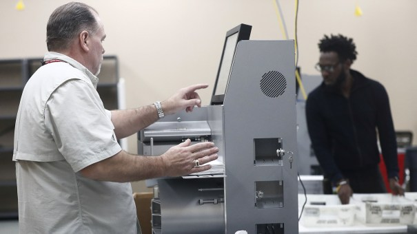 Workers load ballots into machines at the Broward County Supervisor of Elections office during a recount on Sunday in Lauderhill, Fla.