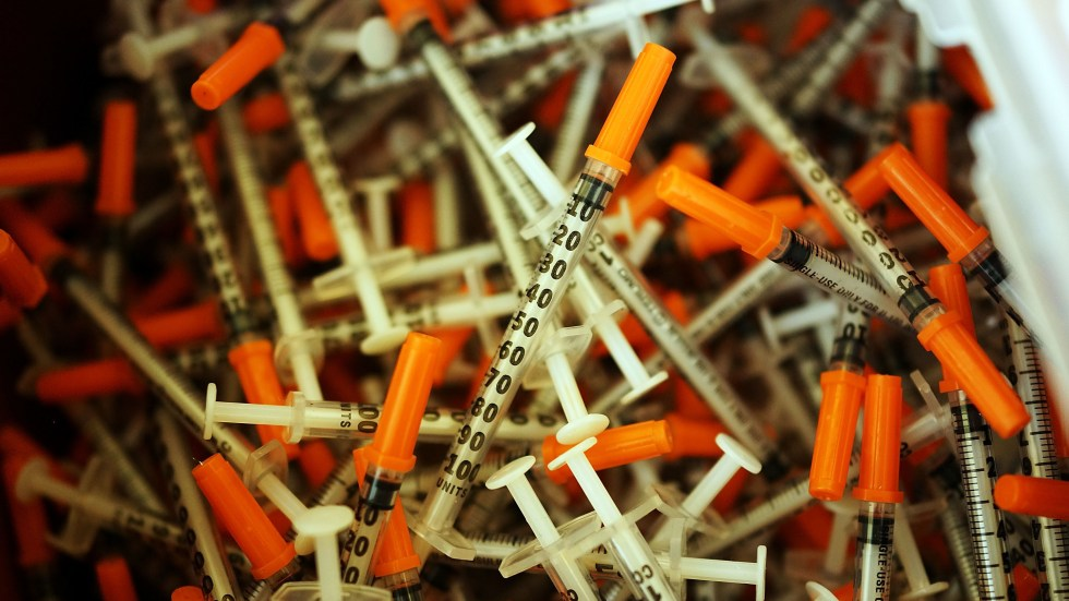 Used syringes are discarded at a needle exchange clinic in Vermont in 2014. Americans