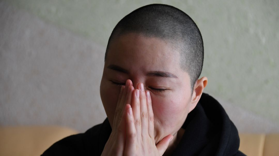 Li Wenzu, the wife of imprisoned lawyer Wang Quanzhang, reacts before an interview at her home in Beijing. Prominent Chinese human rights lawyer Wang Quanzhang was sentenced on January 28 to four and a half years in prison for state subversion.