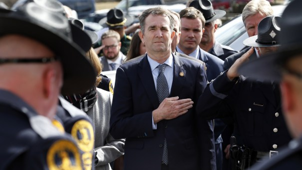 Virginia Gov. Ralph Northam places hand over his heart at a funeral for a state trooper Saturday in Chilhowie, Va., during one of his first public appearances since the blackface scandal broke.