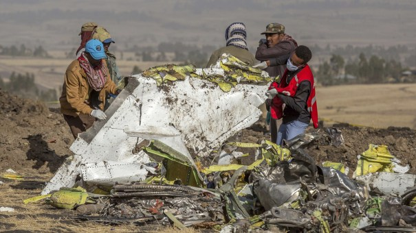 Rescuers work at the scene of an Ethiopian Airlines flight crash. Countries around the world have grounded their Boeing 373 MAX jets and there is growing political pressure on the Federal Aviation Administration to do the same.