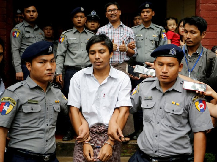 Detained Reuters journalists Kyaw Soe Oo and Wa Lone are escorted by police as they leave after a court hearing in Yangon, Myanmar, in August. Myanmar's top court rejected their appeal Tuesday, letting their seven-year prison term stand. Ann Wang/Reuters