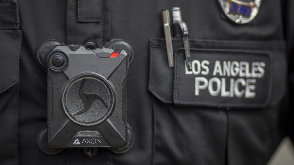 A Los Angeles police officer wears an Axon body camera in 2017. On Thursday, the company announced it is holding off on facial recognition software, citing its unreliability.