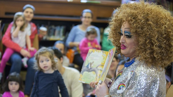 Lil Miss Hot Mess reads to children during a Drag Queen Story Hour in Brooklyn, NY. The event is held in libraries across the country, including, in the past, at the Carnegie Library of Pittsburgh.