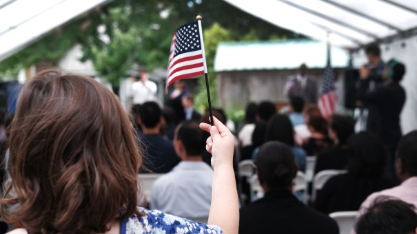 A child holds a U.S. flag at a naturalization ceremony at the Wyckoff House Museum in Brooklyn, on June 14, in New York City.