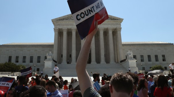People gather in front of the U.S. Supreme Court last week, some opposing the controversial citizenship question the Trump administration tried to add to the 2020 census.