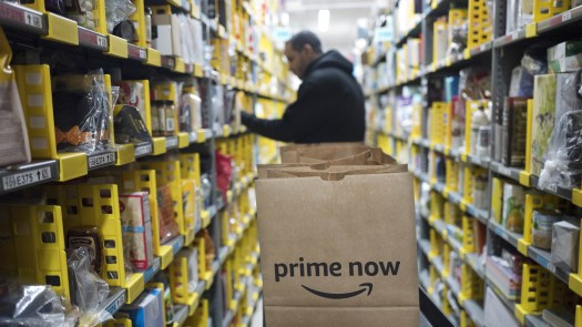 A clerk pick an item for a customer order at the Amazon Prime warehouse in New York. Amazon Empire director James Jacoby describes the pace of work within the company