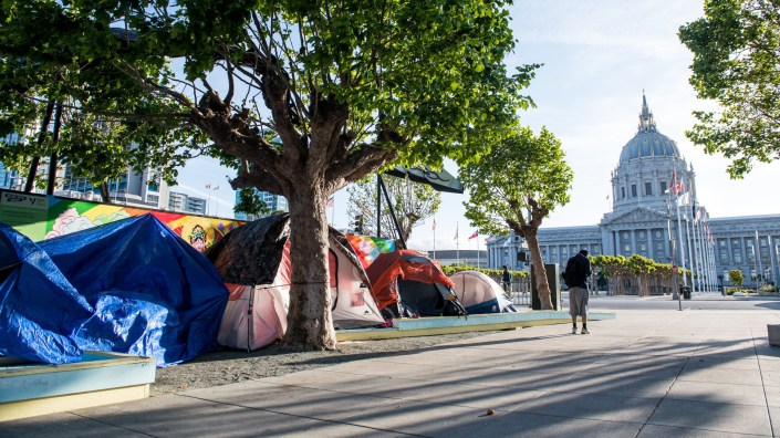 Tents line a gravel sidewalk off Fulton Street near City Hall on May 5, 2020. Last week, city staffers started drawing out socially distant spaces with chalk on the street for the tents to stay.