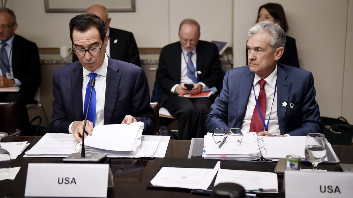 Treasury Secretary Steven Mnuchin, left, and Federal Reserve Board Chair Jerome Powell attend a meeting of world finance ministers and central bank chiefs in October 2019 in Washington, D.C. The two testify at the Senate Tuesday.