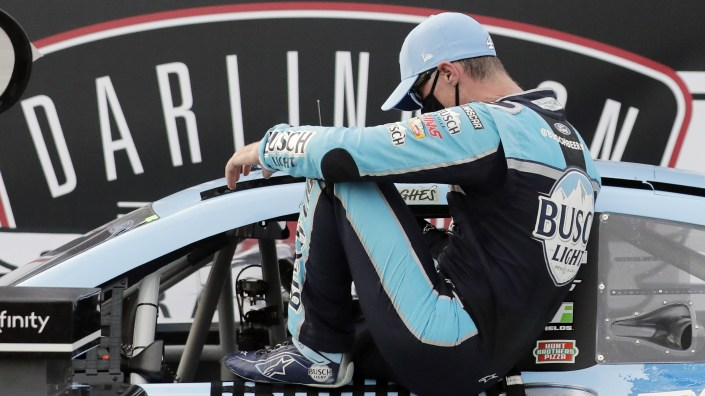 Kevin Harvick gets out of his car in victory lane after winning the NASCAR Cup Series auto race on Sunday.