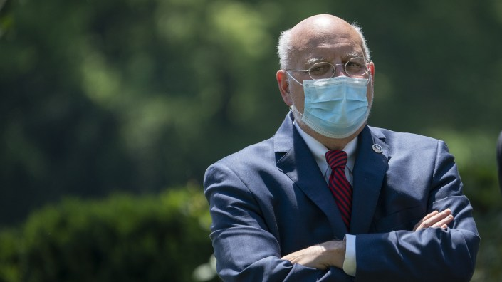 Dr. Robert Redfield, director of the Centers for Disease Control and Prevention, pictured earlier this month in the Rose Garden of the White House, says a new analysis supports the effectiveness of the CDC
