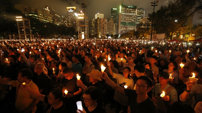 Thousands of people attend a candlelight vigil for victims of the Chinese government