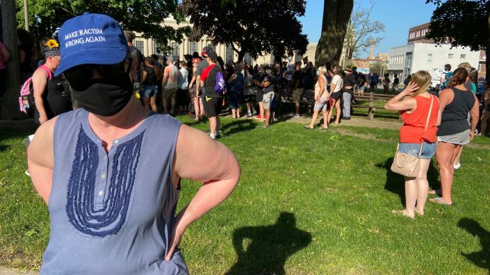 "Wearing a mask to protect herself from the coronavirus and a hat that reads ""Make Racism Wrong Again,"" Lydia Spottswood joins a protest in Kenosha, Wisc., in response to George Floyd"