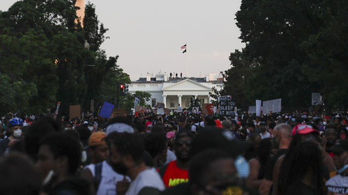 Demonstrators protest Saturday near the White House over the death of George Floyd, a black man who died in police custody in Minneapolis.