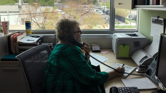 Debbie Sorensen, an infectious disease nurse with Salt Lake County Public Health Department in Salt Lake City, talks by phone with a woman who recently tested positive for the coronavirus. Sorensen is one of the county
