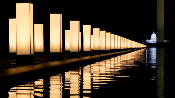 Lights surround the Lincoln Memorial Reflecting Pool, placed as a memorial to COVID-19 victims on Tuesday.