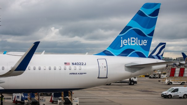 A JetBlue aircraft sits on the tarmac. The company is one of many commercial airlines to experience unruly passenger incidents over the past year.