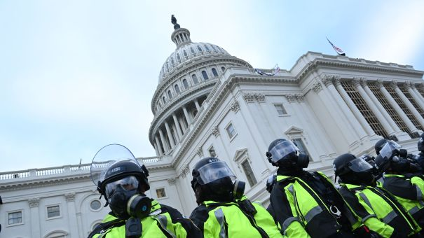 Police stand in a line outside the U.S. Capitol on Jan. 6, 2021.