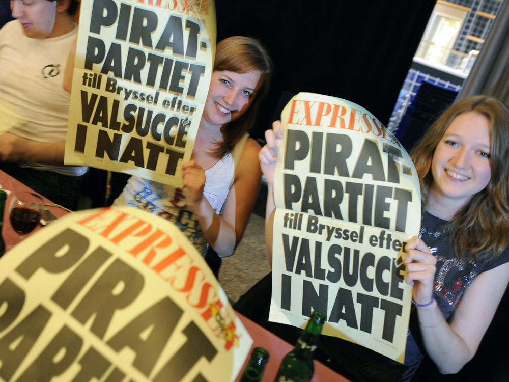 Sweden's Pirate Party supporters react after the results of the European parliamentary elections on