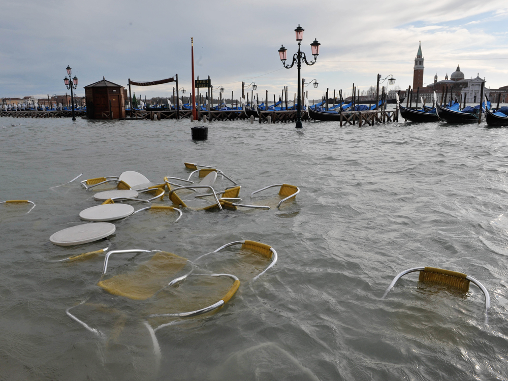 Bar tables and chairs float in flooded Venice. Piero Nascimbeni/New Venice Consortium/AP