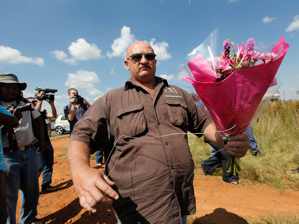 Followers of Eugene Terreblanche bring flowers. Jerome Delay/AP