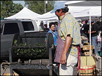 Chile farmer Matt Romero turns his roaster by hand at the Santa Fe Farmers Market.