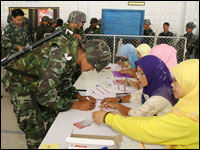 Thai Muslim polling clerks check voters list for soldiers