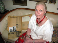 Kathleen Hensley Portalski with newspaper clippings of her, and Cindy McCain's, father in WW2.