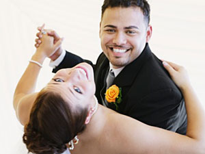 A wedding couple enjoys their first dance.