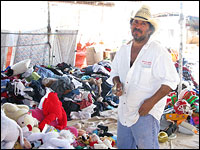 Jose Rincon is seeing little business at his swap meet.
