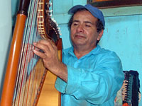 Lifelong harpist Don Benitez performs in his home